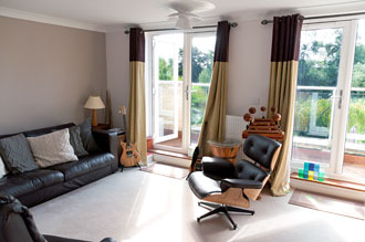 Relaxation room with balcony overlooking the river and nature reserve